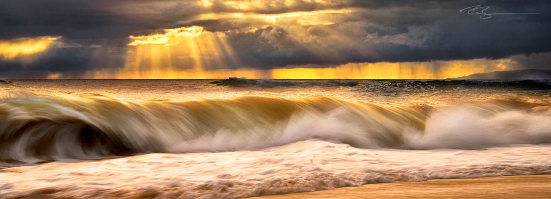 Kauai, Hawaii sunset storm breaking over a wave