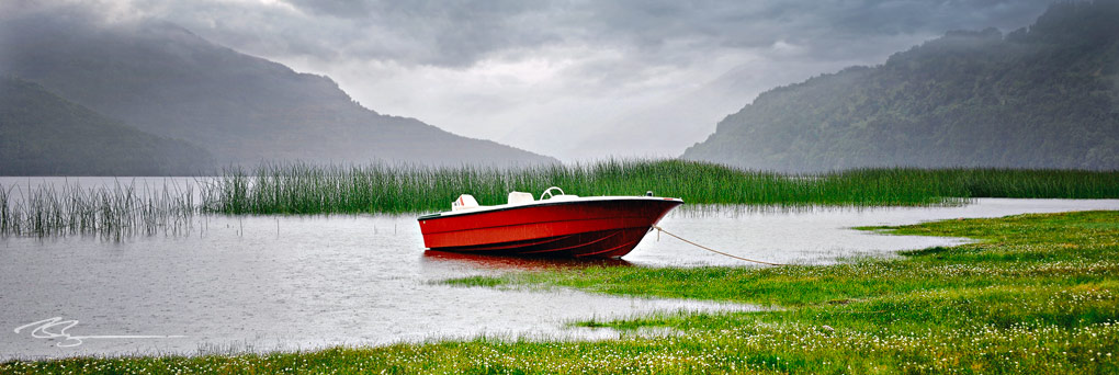 red boat in lake in patagonia argentina